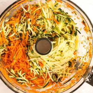 shredded grated carrots in processor